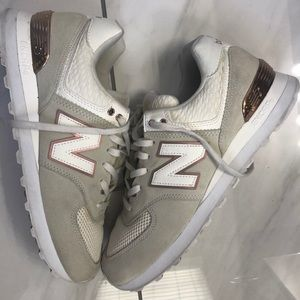New balance rose gold accent sneakers.